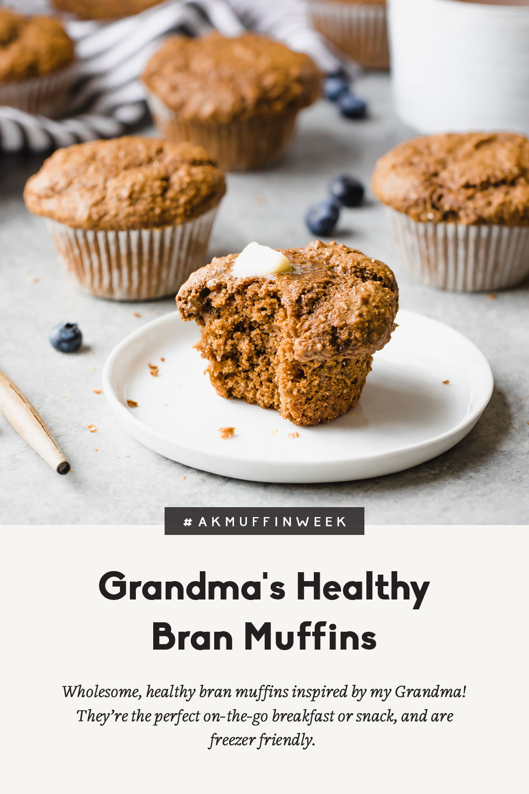 healthy bran muffin on a plate with blueberries and muffins on a grey board