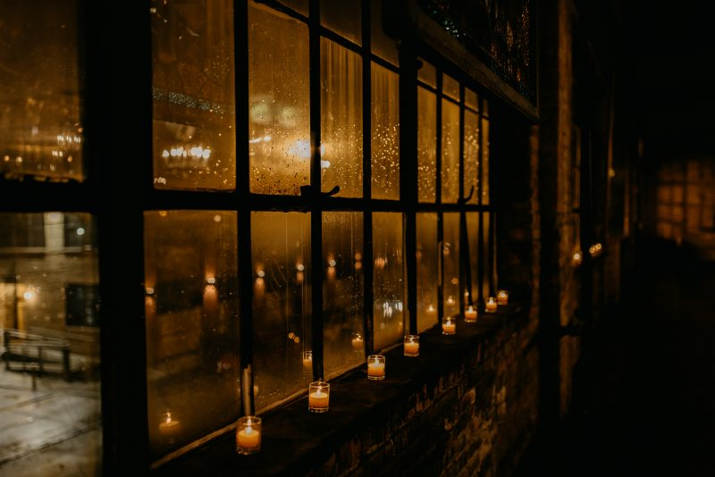 windows with candles underneath them