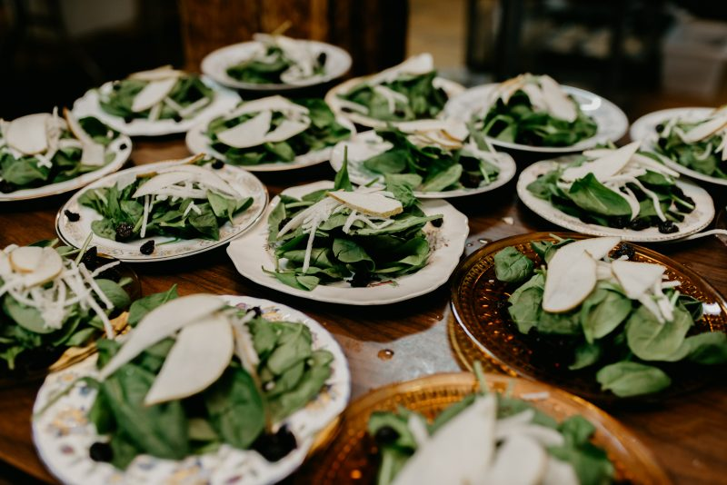 plates of salad on a table