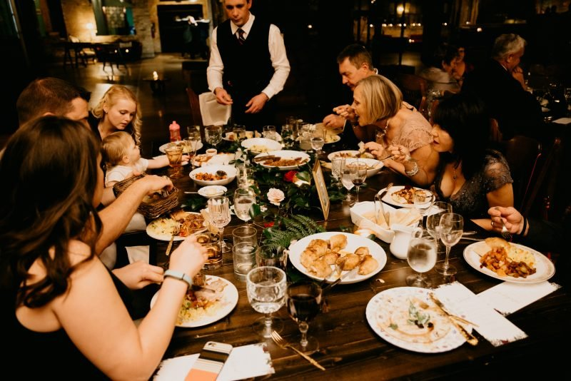 people eating at a wedding