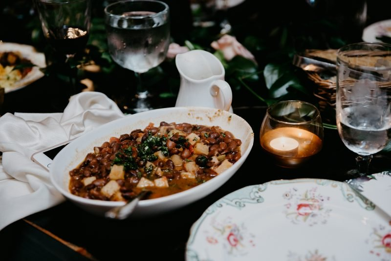 bowl of beans and potatoes on a table