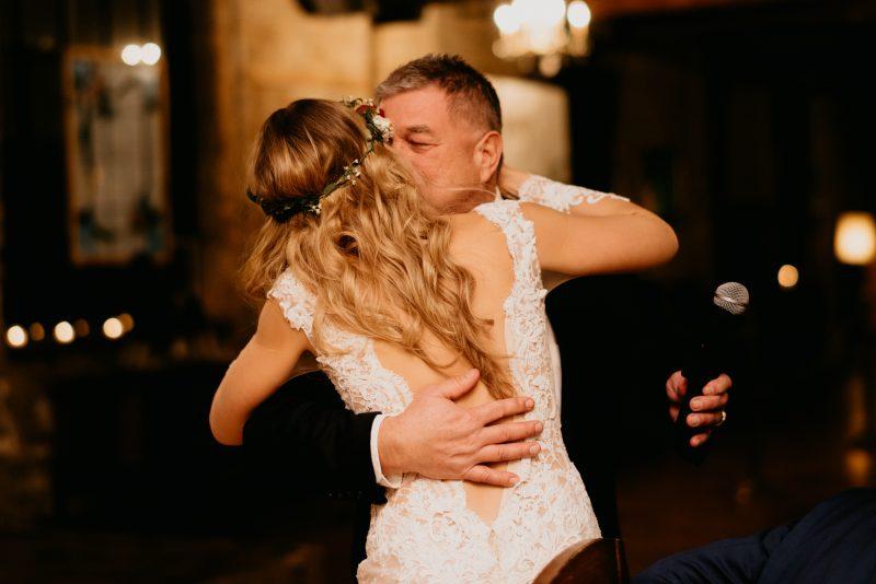 godfather hugging the bride