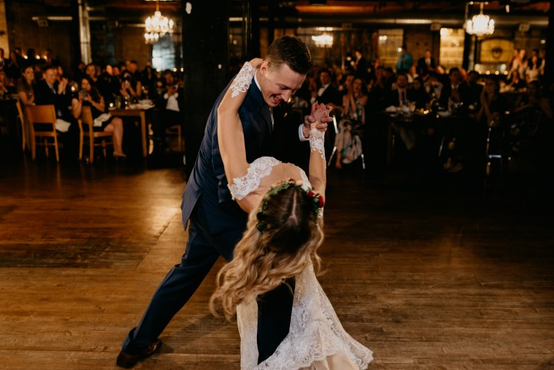 groom dipping the bride on a dance floor