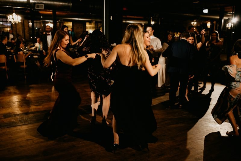 people dancing at a wedding