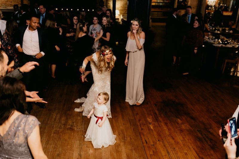 bride and flower girl dancing at a wedding