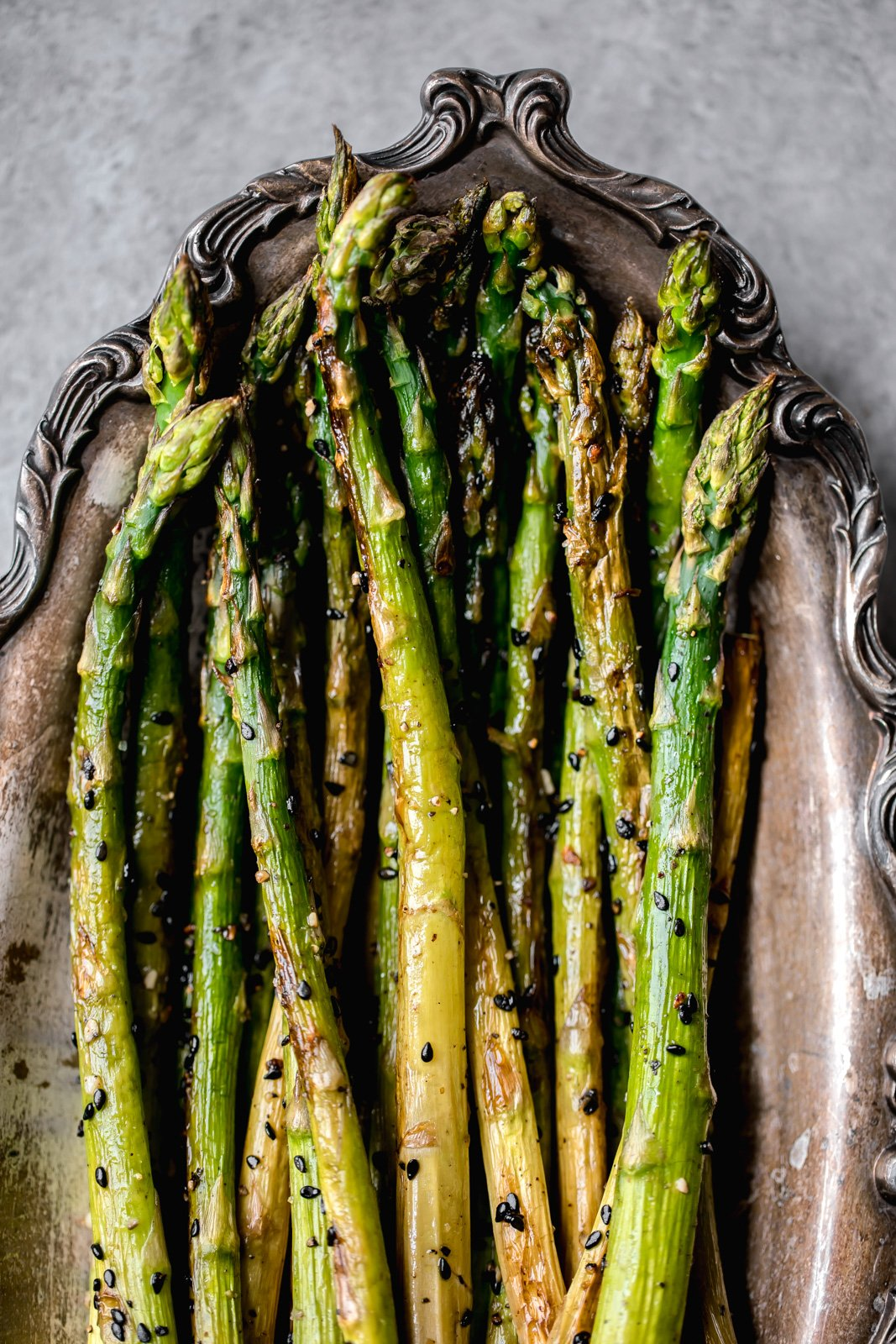 roasted asparagus on a platter