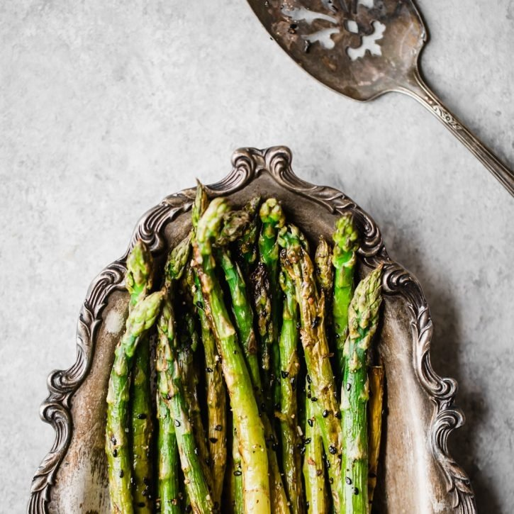 sesame garlic roasted asparagus on a platter
