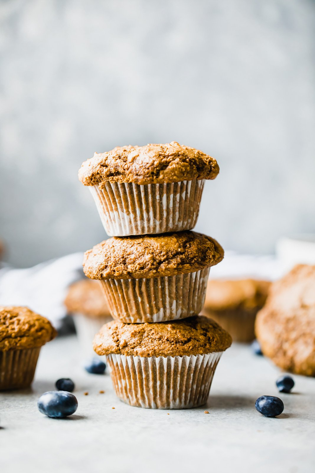 three healthy bran muffins stacked