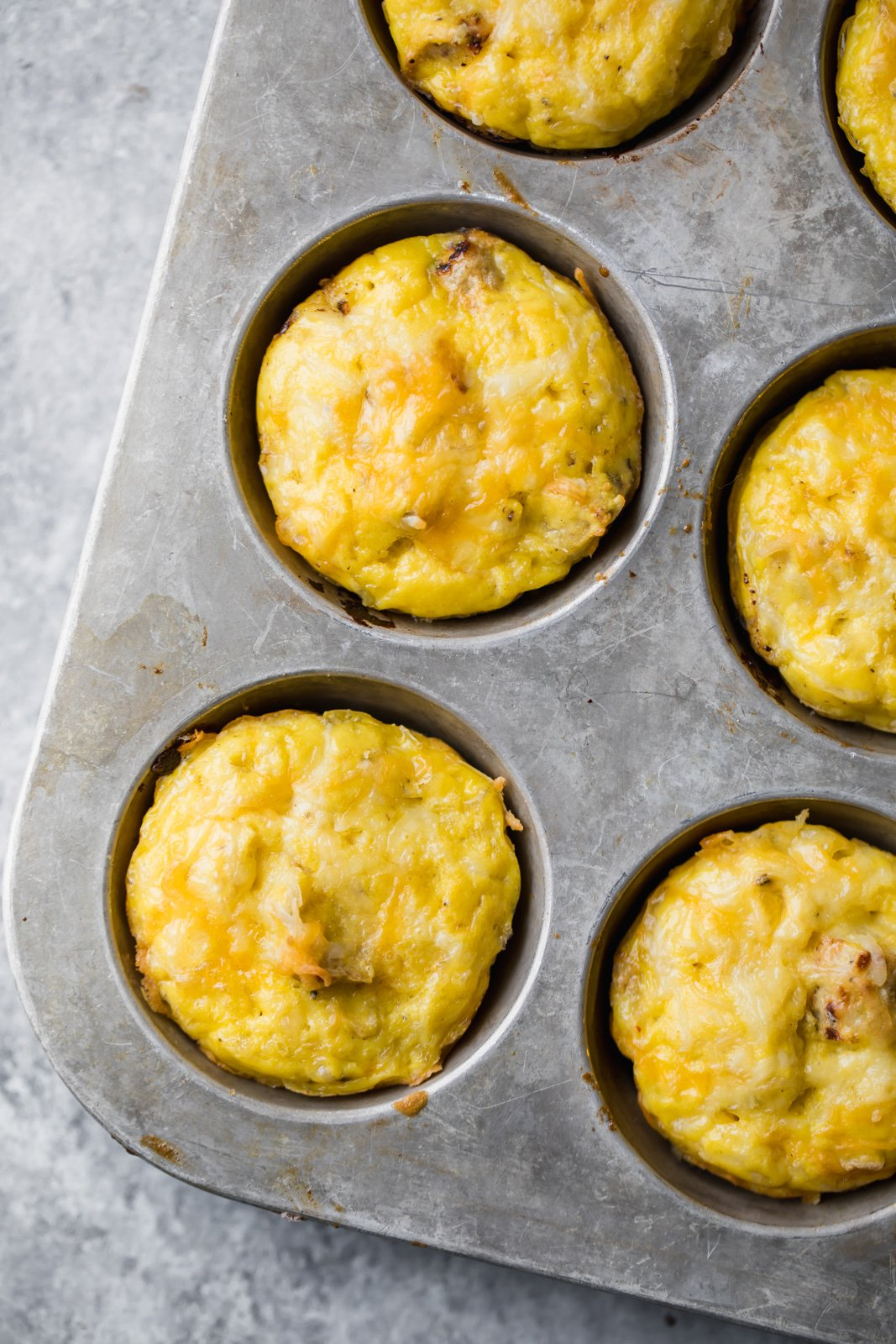 sausage, egg and cheese muffins in a muffin tin
