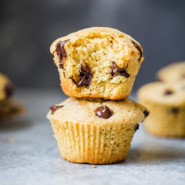 healthy orange chocolate chip muffins in a stack