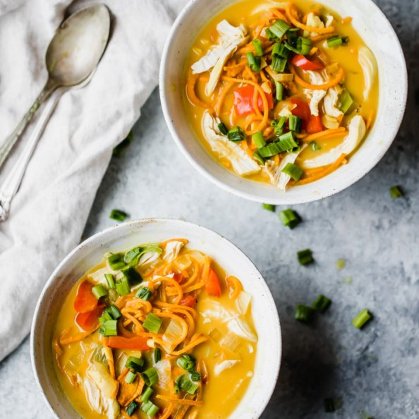 Coconut Chicken Sweet Potato Noodle Soup in two bowls