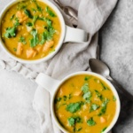 butternut squash lentil soup in two mugs
