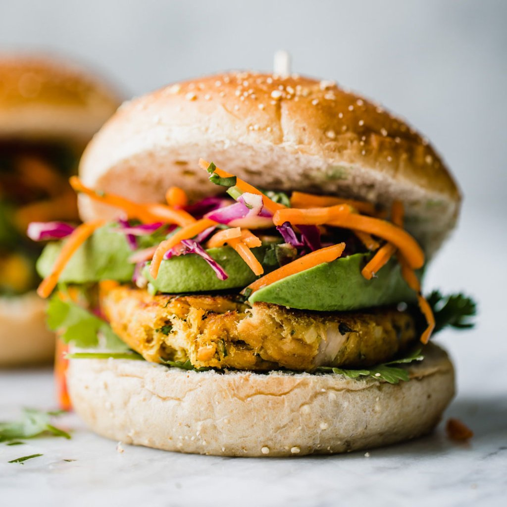 thai tuna patties on a pun with cabbage slaw and avocado