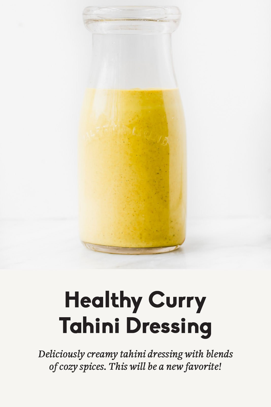 Healthy curry tahini dressing in a clear jar