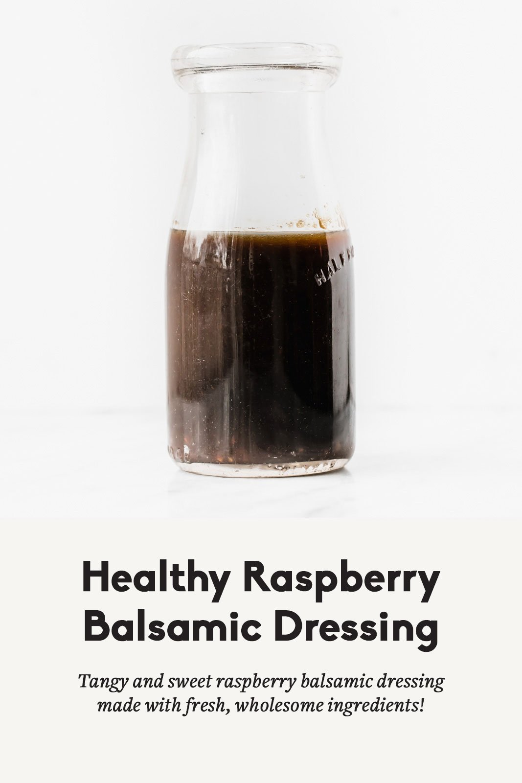 Healthy raspberry balsamic dressing in a clear glass