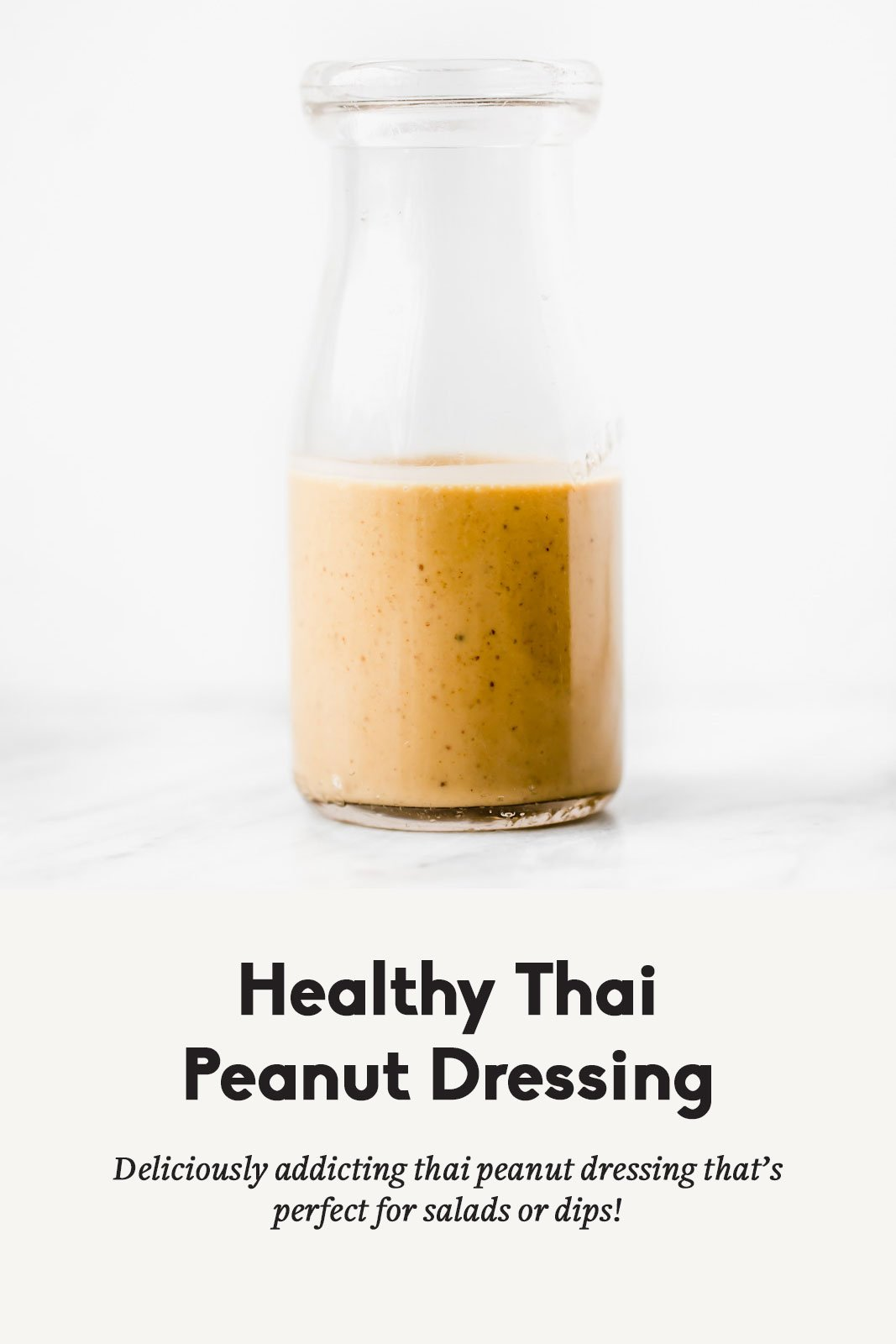Healthy thai peanut dressing in a glass container