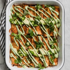 vegan butternut squash enchiladas in a pan
