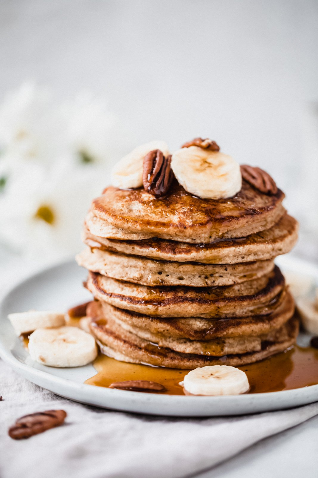 healthy banana oatmeal pancakes in a stack on a plate