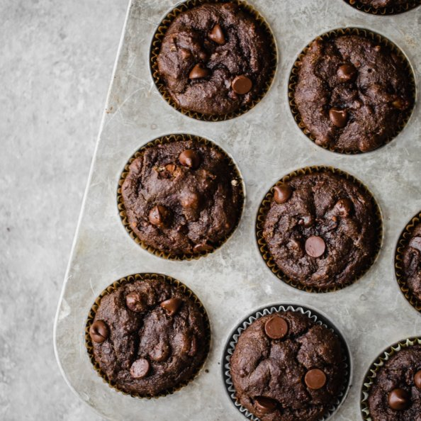Double chocolate tahini banana muffins in a muffin tin