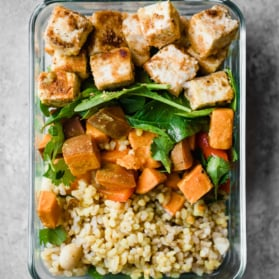 tofu, rice, and sweet potato in a meal prep container