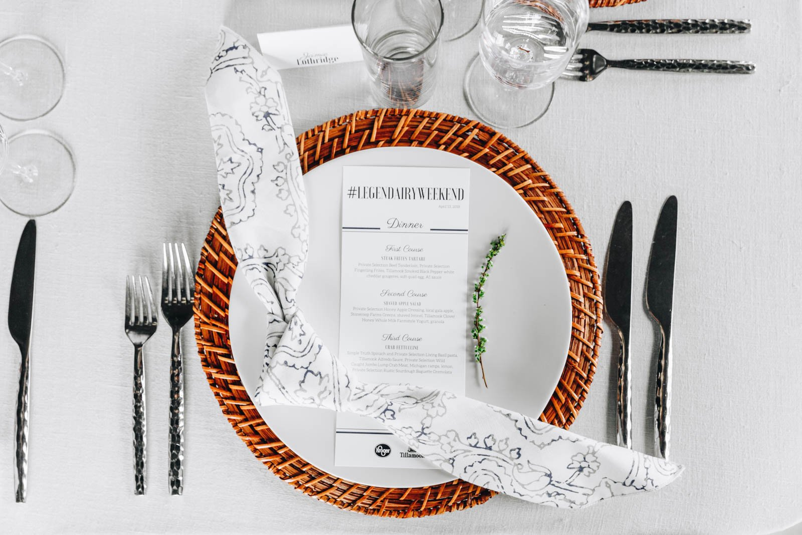 white place setting with a white napkin