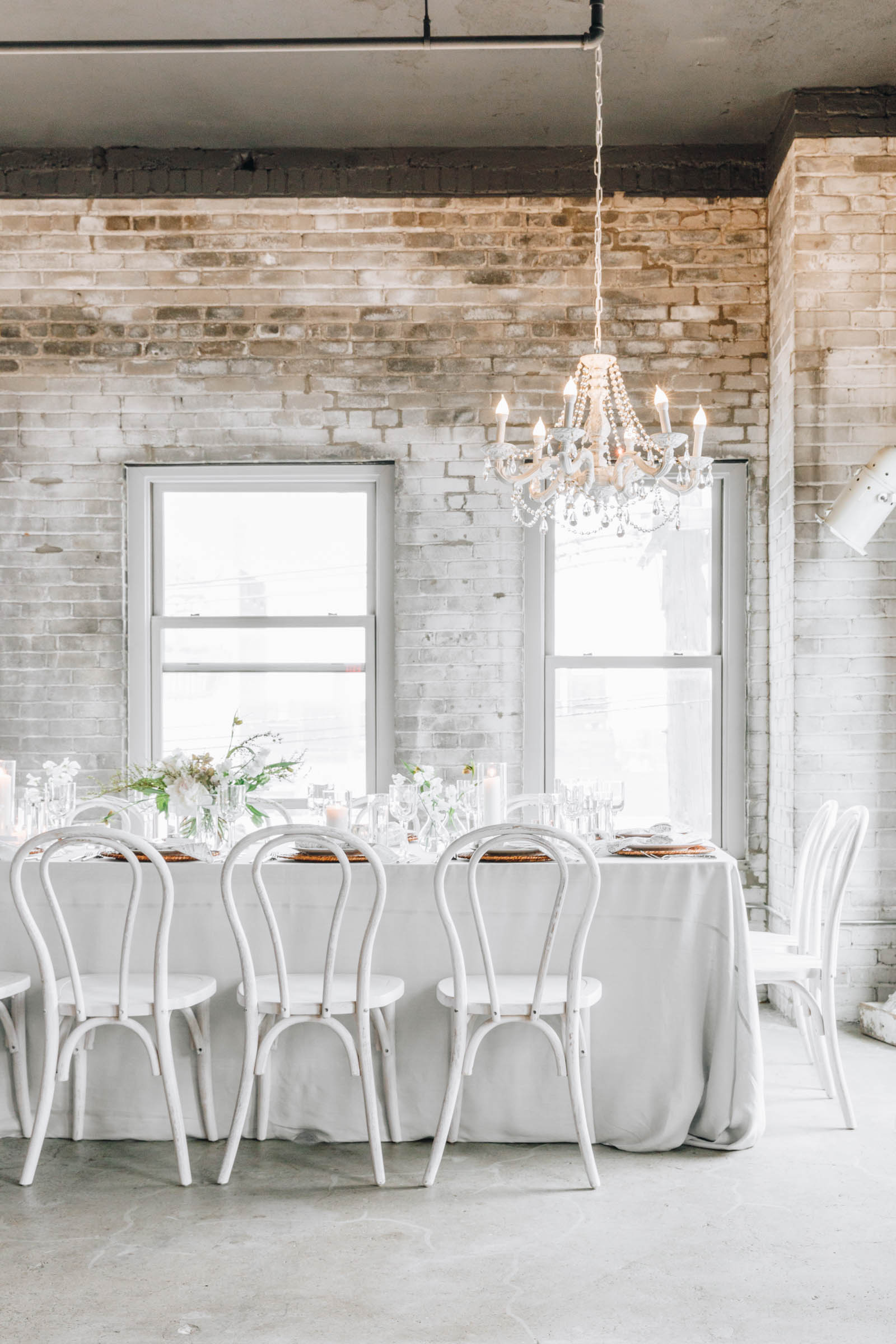 white table setting with white chairs