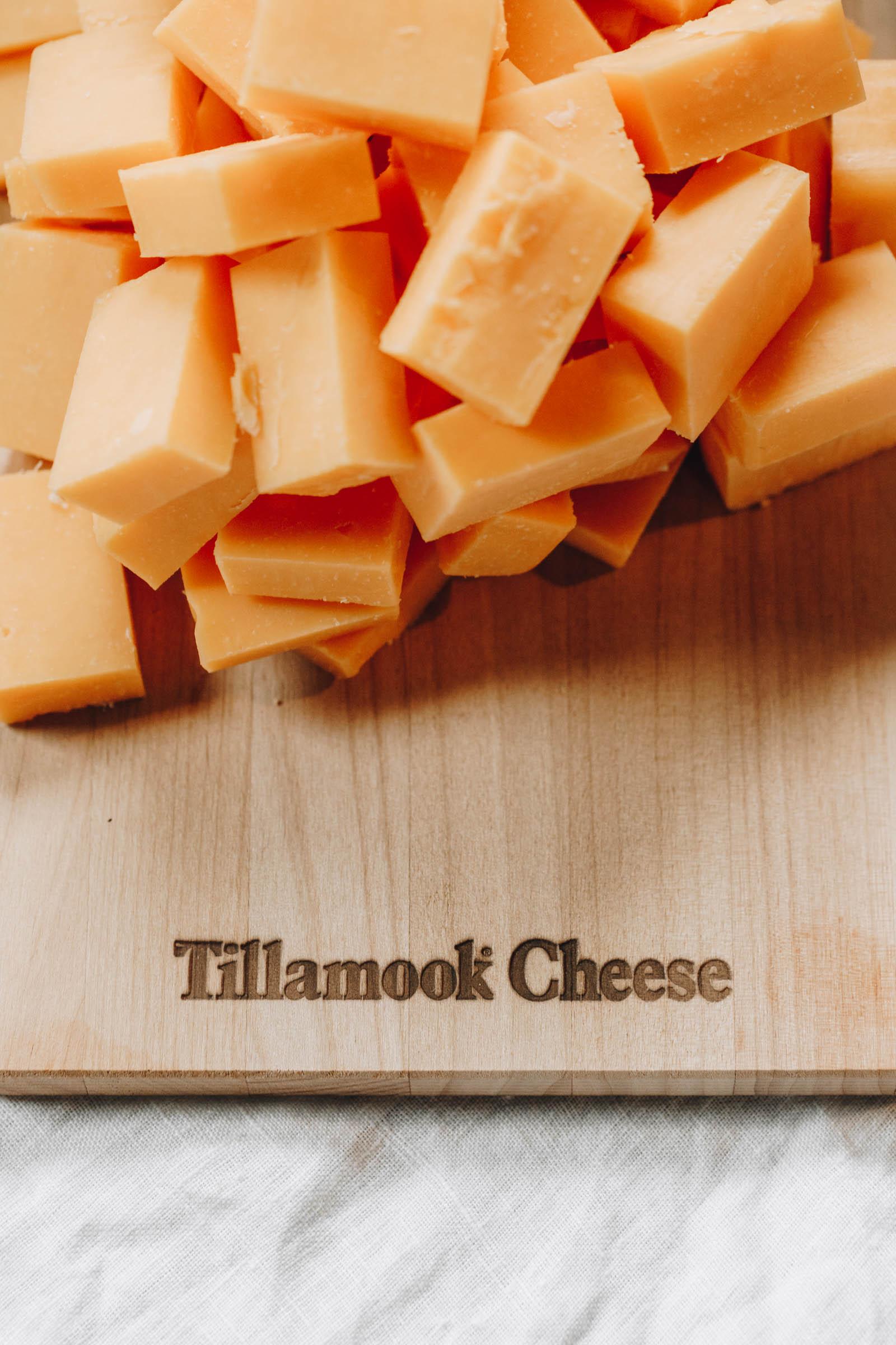 cheddar cheese cubes on a cutting board