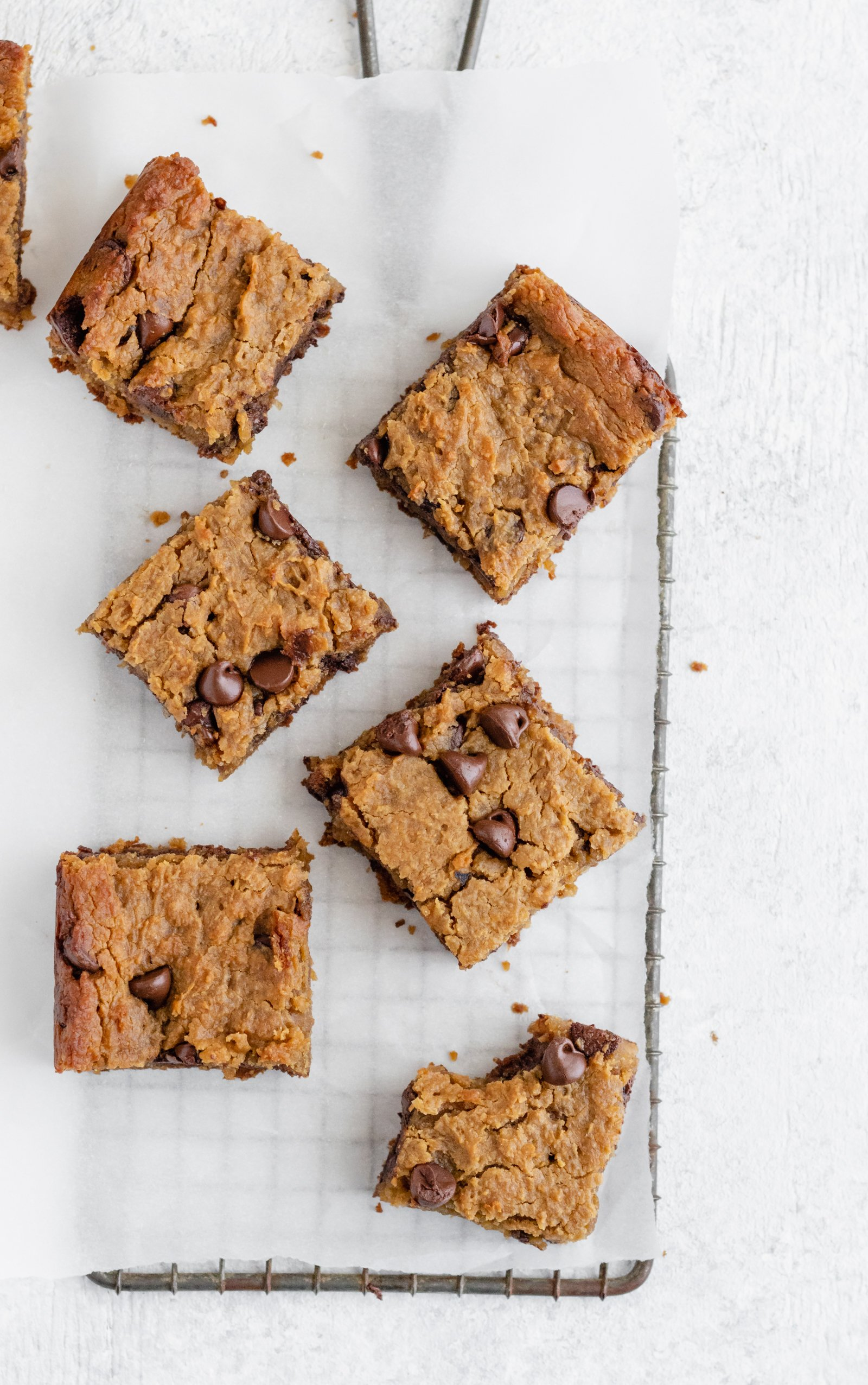 Secretly healthy chickpea blondies made with chickpeas, peanut butter, pure maple syrup and chocolate. Taste amazingly like peanut butter cookies. Flourless and no butter!