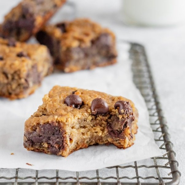 flourless chocolate chip chickpea blondies on a wire rack