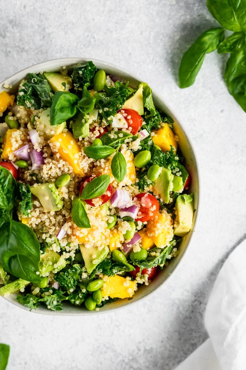 Kale, edamame, quinoa salad with sweet lemon vinaigrette. Packed with juicy mango, tomatoes, heart healthy avocado, nutty quinoa and crunchy kale. This salad is perfect for parties or for packing for lunch.