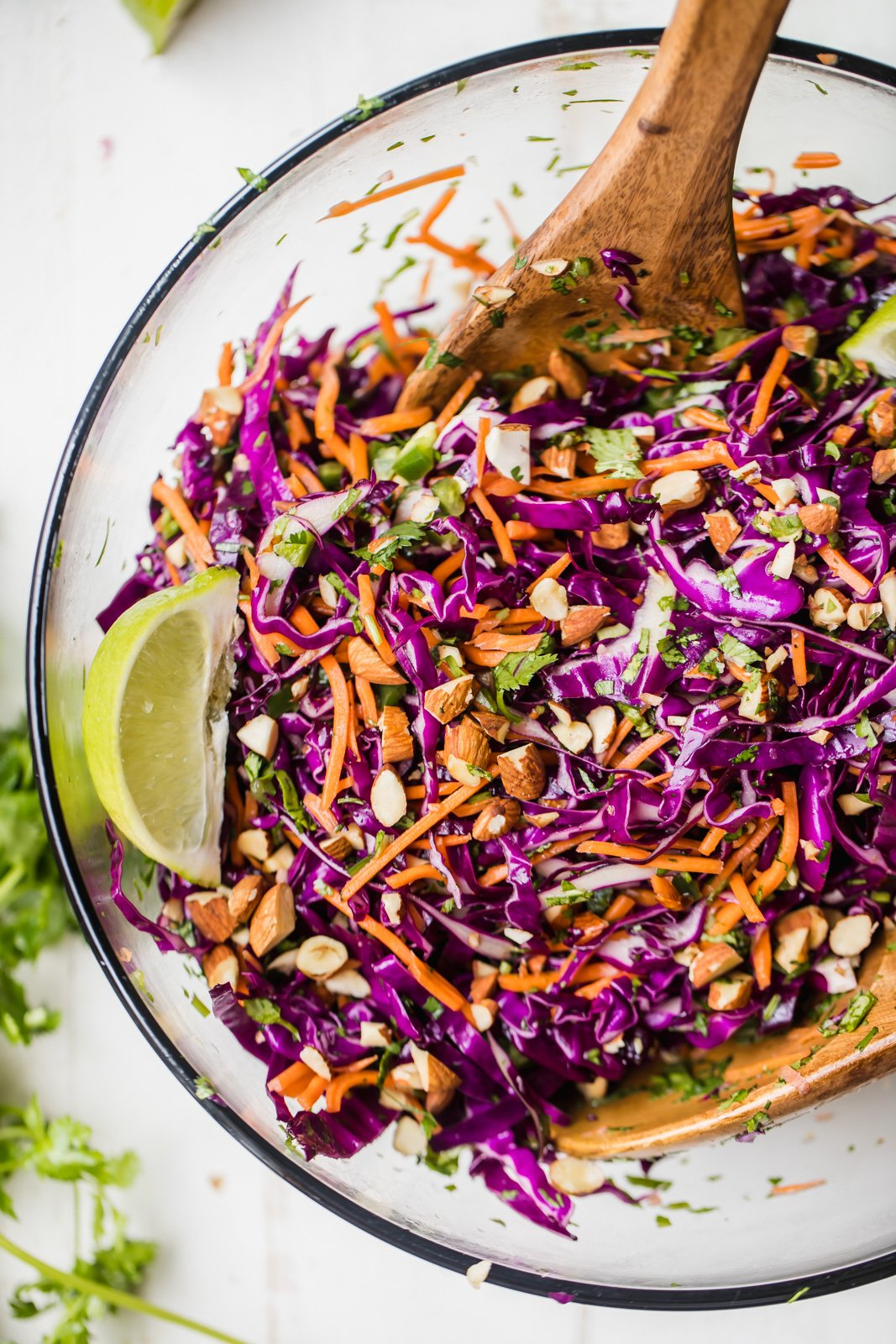 The BEST healthy coleslaw made with fresh purple cabbage, carrots, cilantro, and a kick of heat from jalapeño. There's no mayo, just a naturally sweet and slightly tangy dressing. This simple, healthy coleslaw is perfect serving with your favorite grilling recipes all summer!