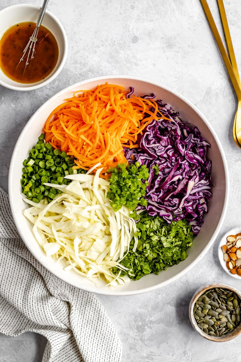 ingredients for coleslaw in a bowl before mixing