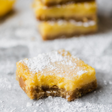 Healthy lemon bars on a grey board
