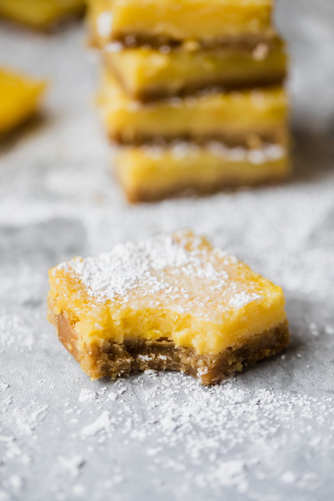 Healthy lemon bars that are gluten free, dairy free and paleo! The crust is made with a mix of almond flour and coconut flour and the light lemon filling is made with just 4 simple ingredients: fresh lemon juice, honey, eggs and coconut flour. You're going to LOVE these easy to make bars -- they're great for parties!