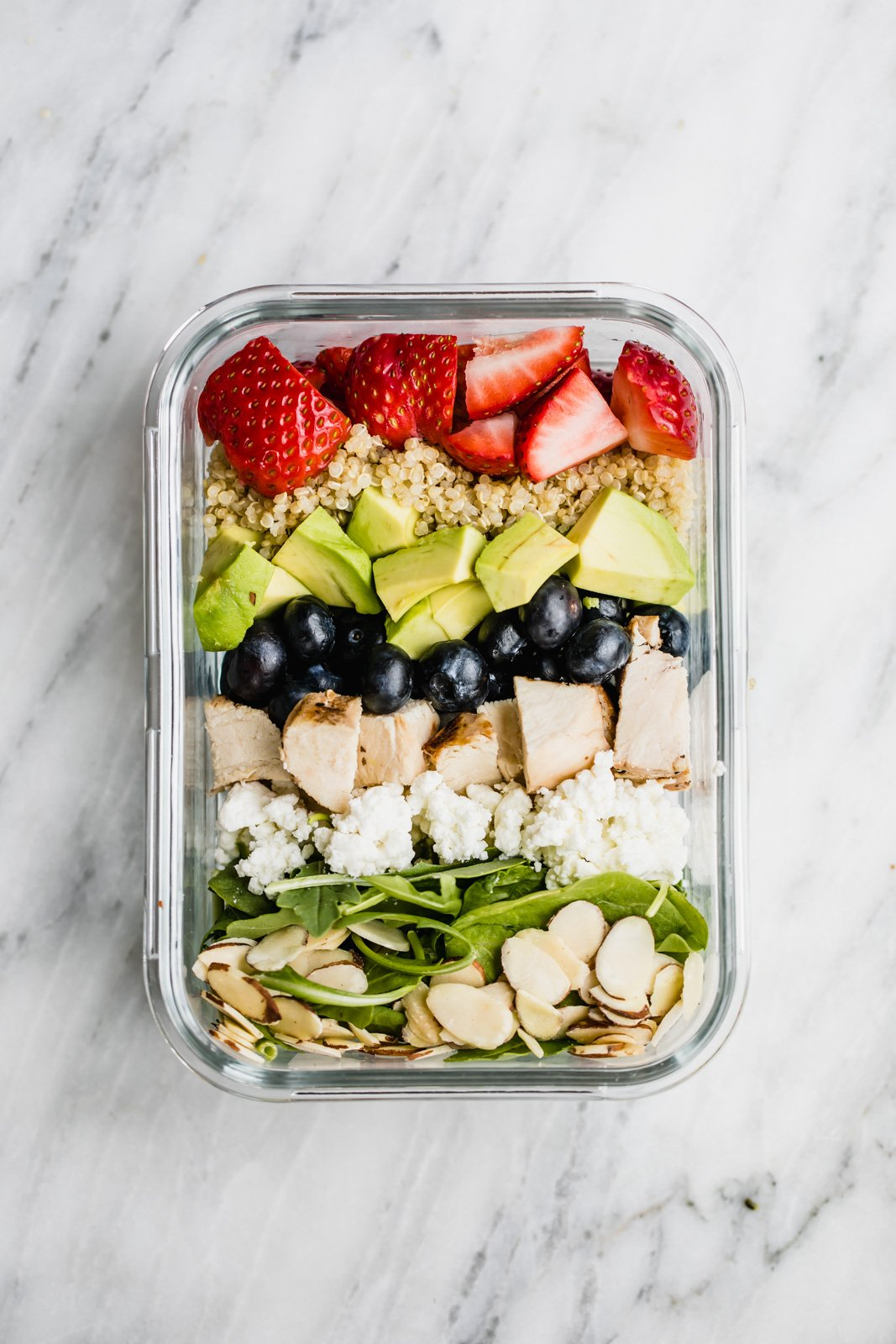 chicken berry quinoa salad in a meal prep container