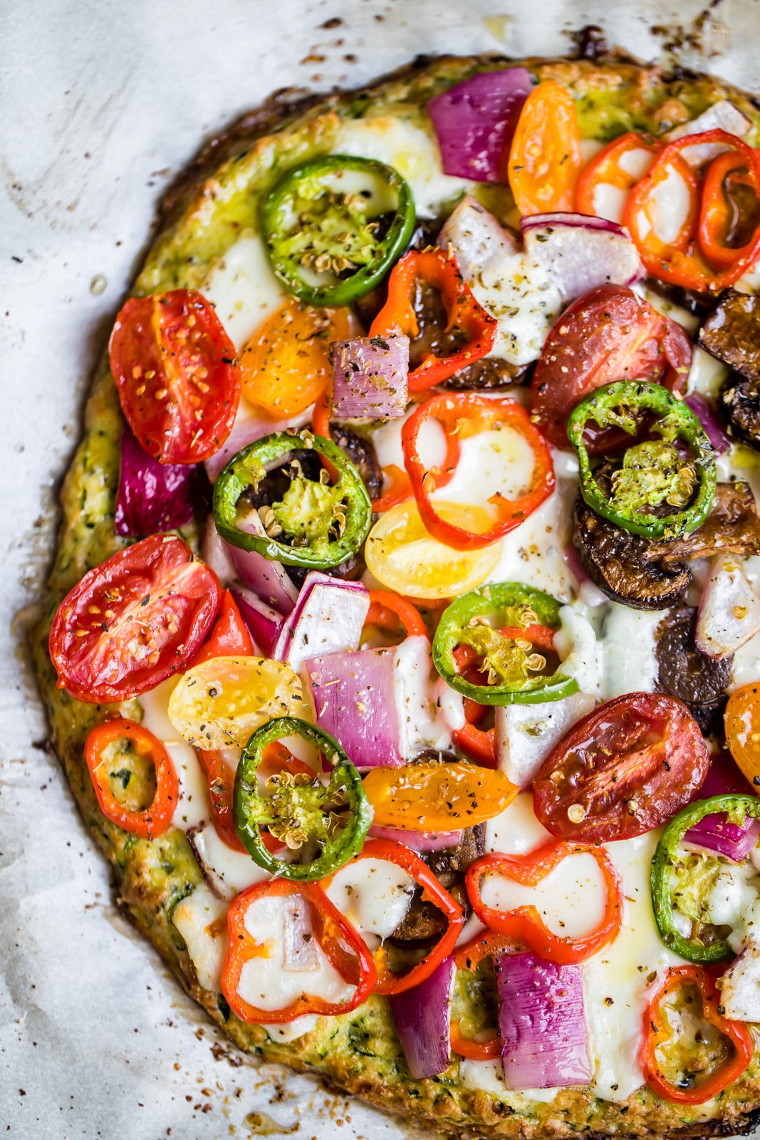 low carb zucchini pizza crust topped with cheese and veggies