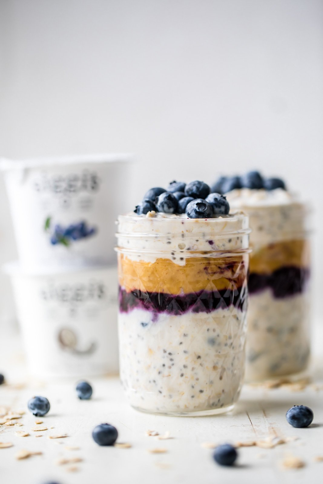 peanut butter blueberry overnight oats in a jar topped with blueberries