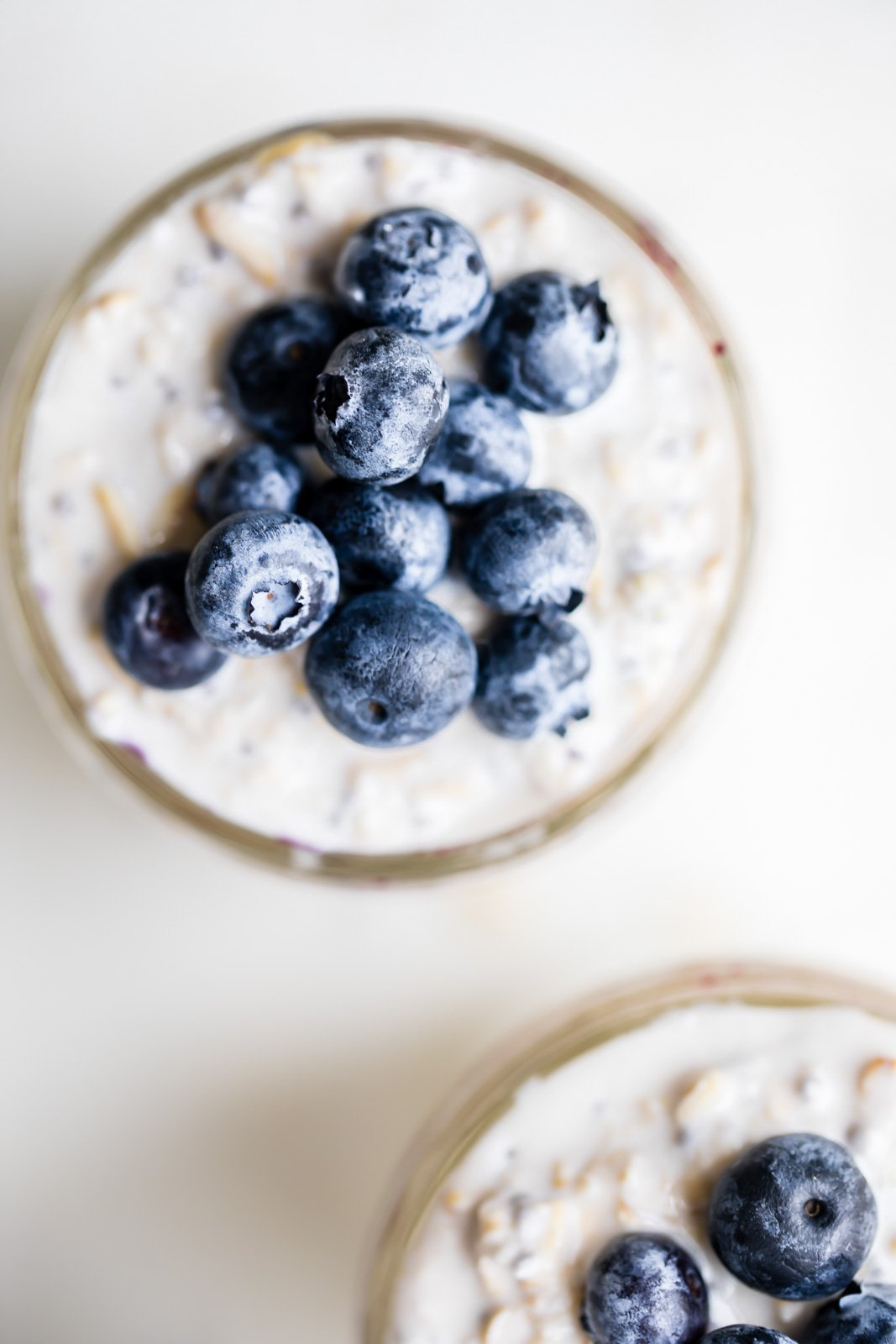 overhead shot of peanut butter blueberry overnight oats topped with blueberries