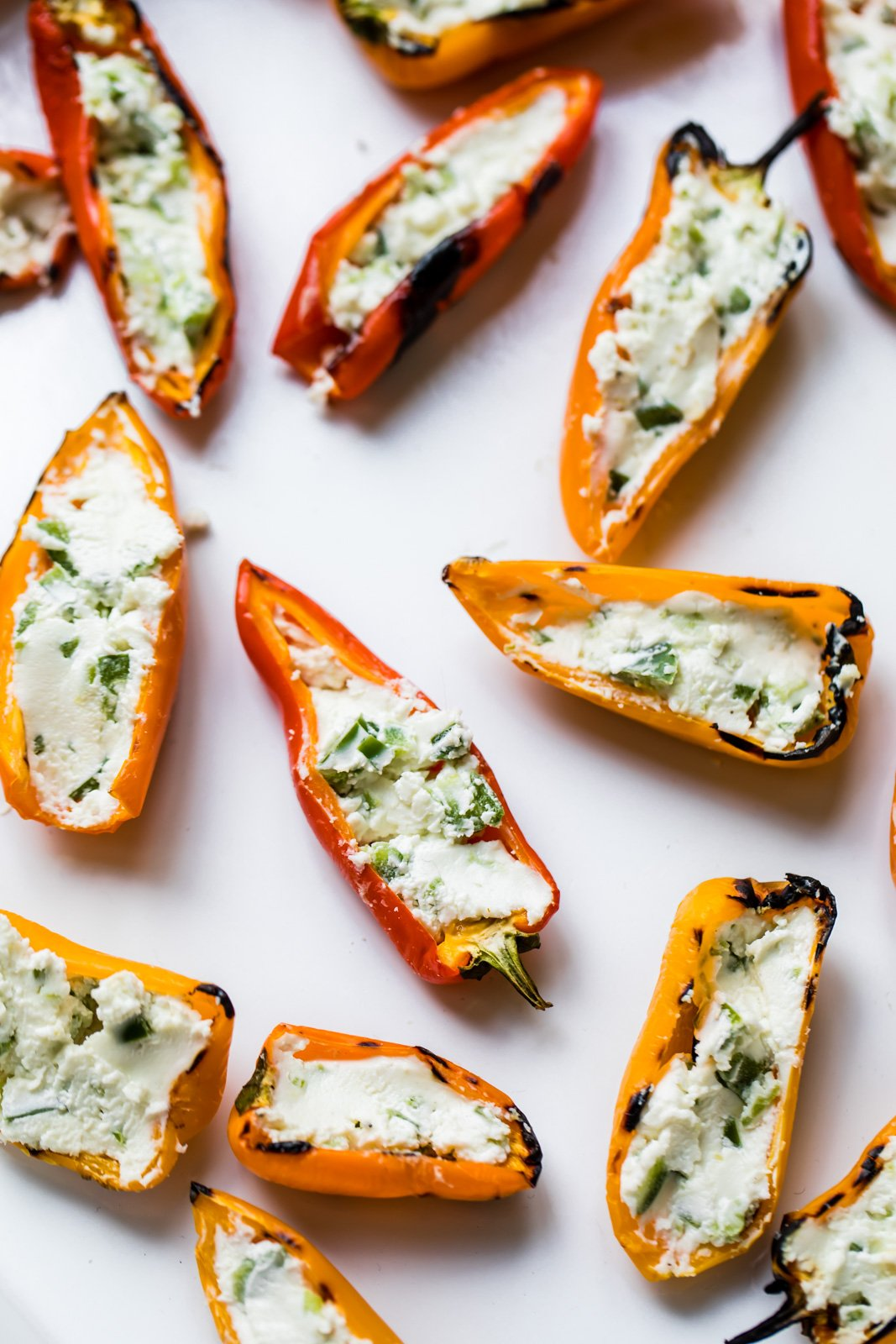 Grilled stuffed mini peppers that are both easy and delicious. This vegetarian appetizer is made with only 3 ingredients -- goat cheese, jalapeños and mini peppers!