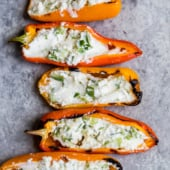 grilled stuffed mini peppers in a line