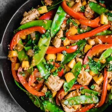 mango chicken stir fry in a skillet pan