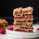 raspberry crumble in a stack on a plate