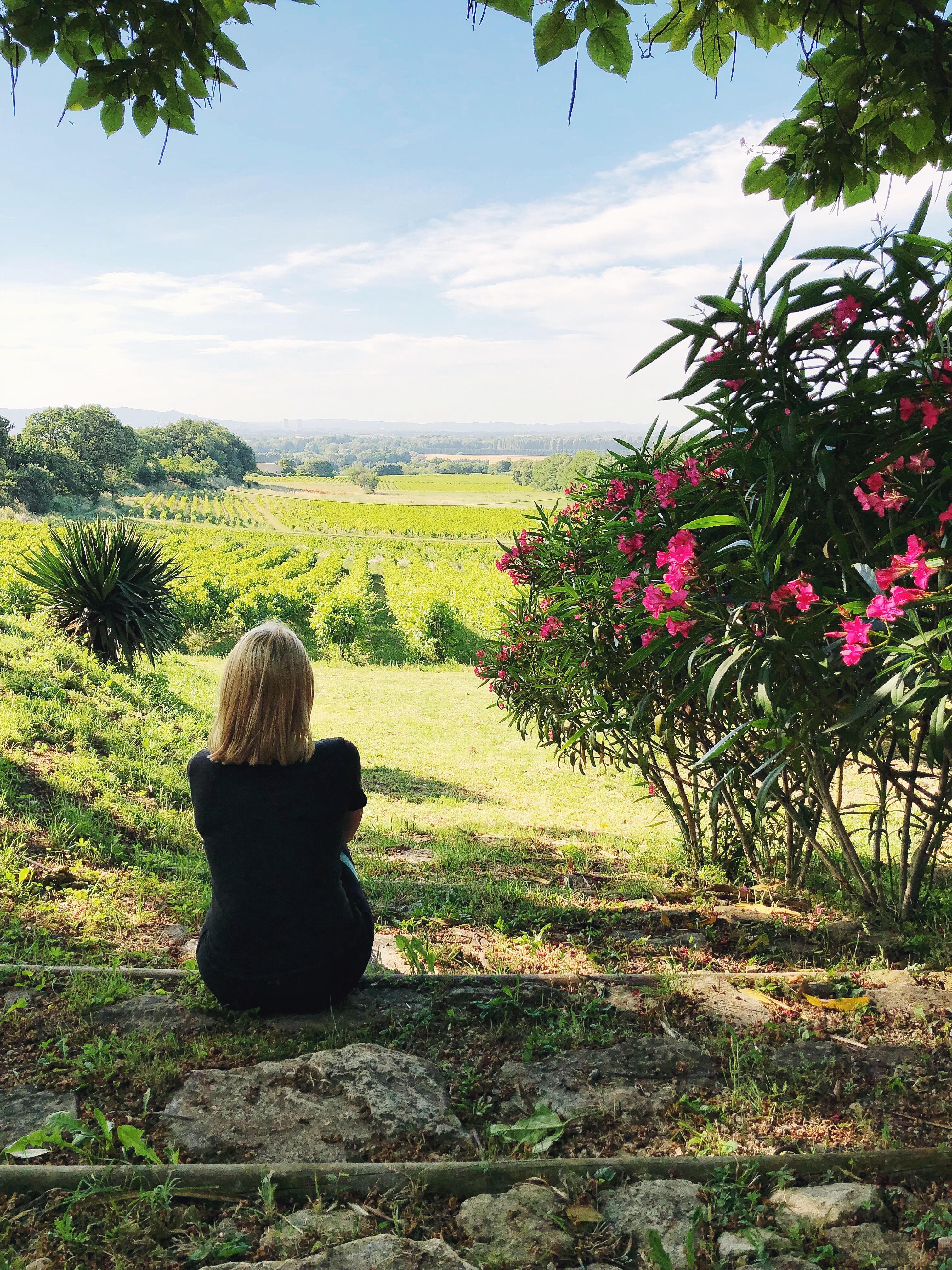 monique overlooking a vineyard