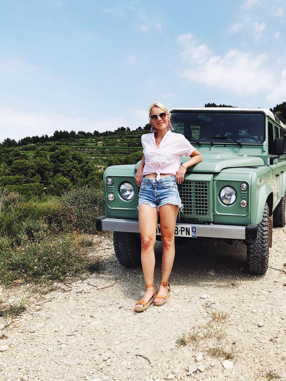 monique in front of a green jeep