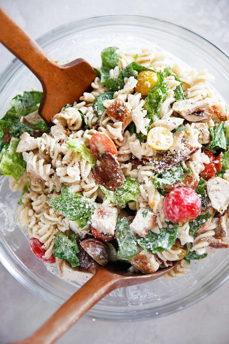 healthy pasta salad recipe in a bowl with tomatoes and romaine