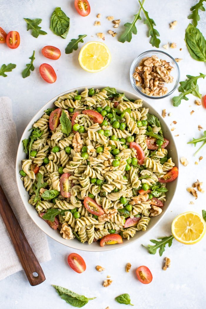 healthy pasta salad recipe in a bowl with peas and tomatoes