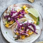 two fish tacos on a plate