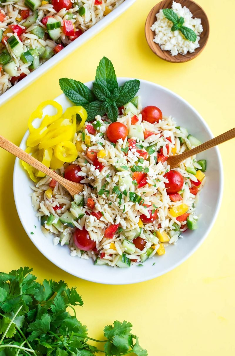 healthy pasta salad recipe in a bowl with tomatoes and yellow peppers