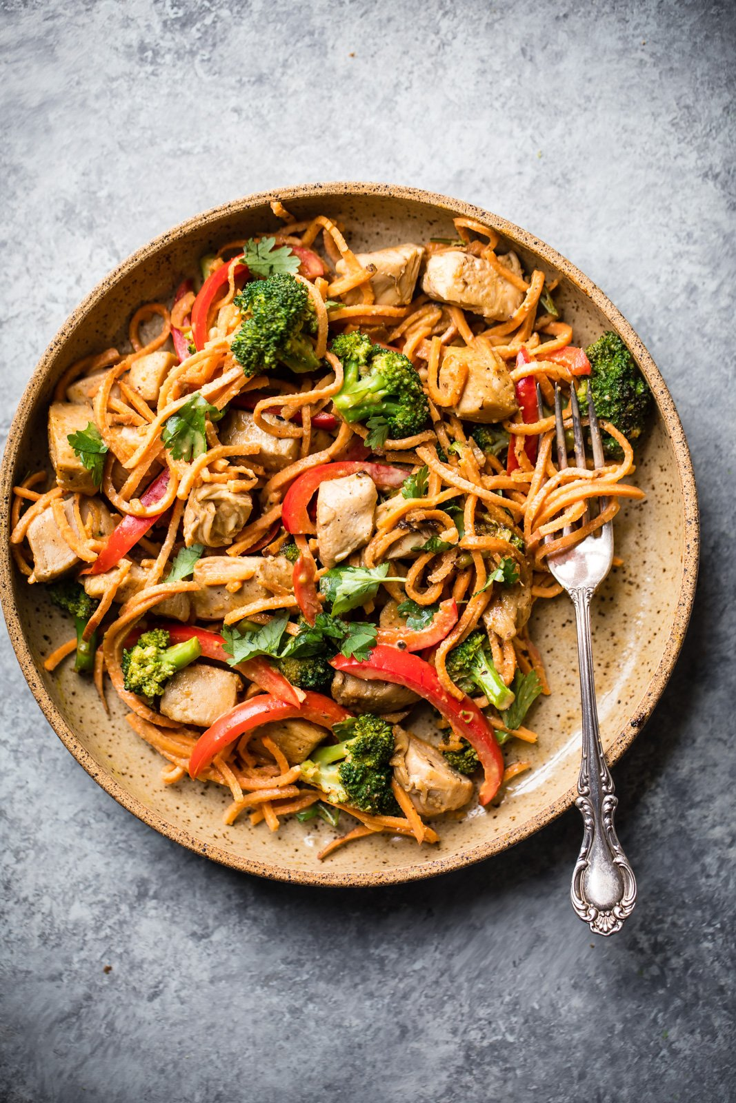 Thai peanut stir-fry with chicken and veggies on a plate