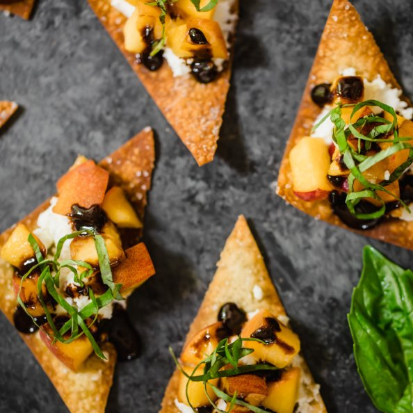 peach and goat cheese wonton bites with shredded basil